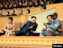FILE - North Korean leader Kim Jong Un, second from left, watches a basketball game between former U.S. NBA basketball players and North Korean players of the Hwaebul team of the DPRK with Dennis Rodman, right. Analysts say Kim sometimes acts like an impatient coach in managing his advisers.