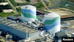 Perusahaan listrik Jepang, Kyushu Electric Power Company mengoperasikan reaktor nuklir di Satsumasendai, Kagoshima, Selasa (11/8).