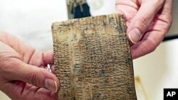 An ancient Persian tablet, about 2,500 years old, containing administrative details on the Persian empire, is seen at the Oriental Institute at the University of Chicago (file photo)