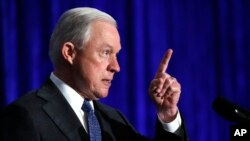 FILE - Attorney General Jeff Sessions speaks in Bethesda, Maryland, June 21, 2017. Sessions is visiting the Guantanamo Bay detention facility, which he has called a fine place to house new terrorism suspects.