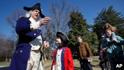 FILE - Lewis Bliss, 10, of Burke, Va., dressed in a musicians outfit from the revolutionary war era, center, meets George Washington, portrayed by Dean Malissa, during Presidents Day activities at George Washington's Mount Vernon Estate.