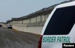 FILE - U.S. Border Patrol vehicles are patrol along the U.S. Mexico border area in San Diego, California, April 21, 2017.