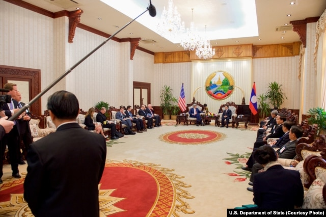 U.S. Secretary of State John Kerry speaks to Laotian Prime Minister Thongsing Thammavong during the outset of a bilateral meeting at the Government House in Vientiane, Laos, Jan. 25, 2016.