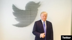 FILE - Donald Trump, during his 2016 presidential campaign, gets ready for a question-and-answer session on Twitter. The president issued a series of tweets Friday related to investigations into possible links between his campaign and Russia.