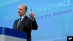 FILE - European Commissioner for Economic and Financial Affairs Pierre Moscovici speaks during a media conference at EU headquarters in Brussels, Jan. 28, 2016.