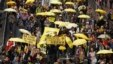 FILE - Protesters carrying yellow umbrellas, the symbol of the Occupy movement, march on a street in Hong Kong, Feb. 1, 2015.