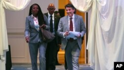 President of IAAF (International Amateur Athletic Federation) Sebastian Coe, right, with President of USA Track & Field (USATF) Stephanie Hightower, left, followed by Frank Fredericks, centre, member of the International Olympic Committee, as they arrive to a press conference after the 202nd IAAF Council Meeting in Monaco, Thursday, Nov. 26, 2015.