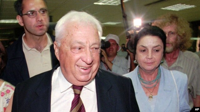 FILE - Israeli Likud party leader Ariel Sharon accompanied by his wife Lily, right, walks in to the Knesset building in Jerusalem before his appointment to the post of Minister of Infrastructure, July 8, 1996.