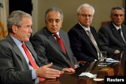 U.S. President George W. Bush sits in on a National Security meeting of ambassadors to the United Nations Security Council, including (2nd L-R) U.S. Ambassador Zalmay Khalilzad, Russia's Ambassador Vitaly Churkin and Italy's Ambassador Marcello Spatafora, to discuss U.S. priorities before the UN, at the White House in Washington, June 25, 2008.