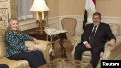 U.S. Secretary of State Hillary Clinton meets with Egyptian President Mohamed Morsi on the sidelines of the United Nations General Assembly in New York, September 24, 2012.