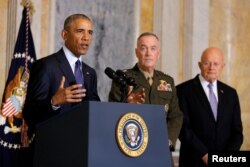 U.S. President Barack Obama delivers a statement accompanied by Director of National Intelligence James Clapper, right, and Chairman of the Joint Chiefs of Staff General Joseph Dunford after a meeting with Obama's national security team at the Treasury Department in Washington, U.S., June 14, 2016.