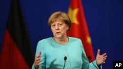 德国总理默克尔2016年6月13日在北京人大会堂的中德经济技术合作论坛上讲话。