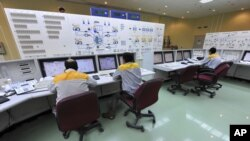 FILE - In this photo released by the International Iran Photo Agency, technicians work at the Bushehr nuclear power plant, outside the southern city of Bushehr.
