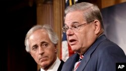 Senate Foreign Relations Committee Chairman Sen. Robert Menendez and the committee's ranking member, Sen. Bob Corker hold a news conference on Capitol Hill in Washington, March 27, 2014, after the Senate passed the Ukraine Aid Bill.