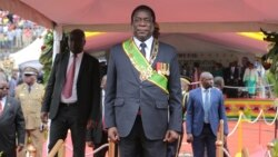 FILE: Zimbabwe's President Emmerson Mnangagwa prepares to inspect the guard of honour at the National Sports Staduim in Harare, Wednesday, April, 18, 2018.