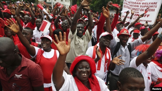 Supporters of the ruling All People's Congress party's President Ernest Bai Koroma attend a rally outside State House in the center of Sierra Leone's capital Freetown, October 11, 2012.