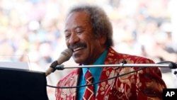 FILE - Allen Toussaint performs at the New Orleans Jazz and Heritage Festival in New Orleans, Louisiana, May 7, 2011.