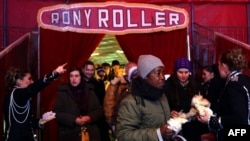 Homeless and needy people arrive at the Rony Roller Circus in Rome after Pope Francis invited them to enjoy the show, Jan. 14, 2016.