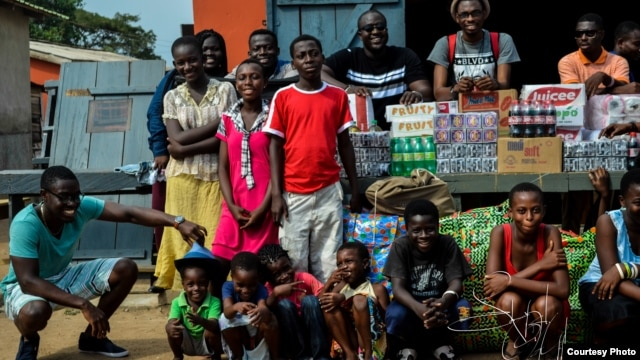 Staff of an Accra promotional firm, Team Tiki, donate proceeds from a recent event to the M'adamfo Pa Orphanage. (Courtesy Team Tiki)