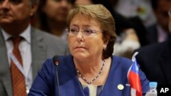 FILE - Chile's President Michelle Bachelet attends the Mercosur Summit in Luque, Paraguay, Dec. 21, 2015.