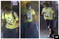 FILE - This Aug. 17, 2015, image, released by Royal Thai Police spokesman Lt. Gen. Prawut Thavornsiri shows a man wearing a yellow T-shirt near the Erawan Shrine before an explosion occurred in Bangkok, Thailand.