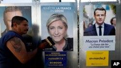 Des affiches de candidats lors de la campagne électorale en France, le 14 avril 2017. (Reuters / Eric Gaillard)