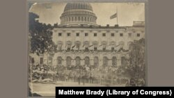 """The Capitol building during the """"grand review"""" of the Union Army in Washington, DC"""