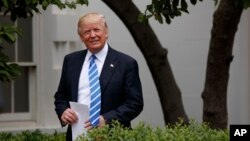 President Donald Trump arrives in the Kennedy Garden of the White House in Washington, May 1, 2017, to speak to the Independent Community Bankers Association.