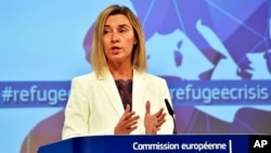 EU High Representative For Foreign Affairs and Security Policy Federica Mogherini, talks to the media prior an emergency EU heads of state summit on migration at the EU Commission headquarters in Brussels, Sept. 23, 2015.