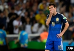 Argentina's forward and captain Lionel Messi reacts after losing the 2014 FIFA World Cup final football match between Germany and Argentina 1-0 following extra-time at the Maracana Stadium in Rio de Janeiro, Brazil, on July 13, 2014.