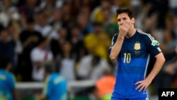 FILE - Argentine forward and captain Lionel Messi reacts after losing the 2014 FIFA World Cup final football match between Germany and Argentina, 1-0, following extra time at the Maracana Stadium in Rio de Janeiro, Brazil, July 13, 2014.