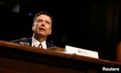 Former FBI director James Comey testifies at a Senate Intelligence Committee hearing on Capitol Hill in Washington, June 8, 2017. Comey said under oath that President Donald Trump put undue pressure on him.