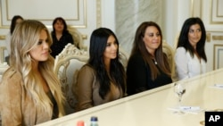 U.S. television personalities Kim Kardashian, second left, and Khloe Kardashian, left, meet with Armenian Prime Minister Hovik Abrahamyan in Yerevan, Armenia, April 9, 2015.