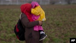 Réfugiés syriens dans le camp d'Idomeni, en Grèce le 4 mars 2016.
