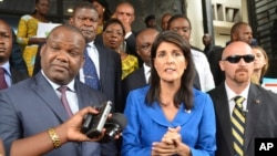 Nikki Haley, U.S. ambassador to the United Nations, center, meets with President of Congo's Election commission, Corneil Nangaa, left, during a meeting in Kinshasa, Congo, Oct. 27, 2017.