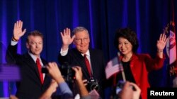 From left, U.S. Republican Senator Rand Paul from Kentucky, Senate Minority Leader Mitch McConnell, McConnell's wife, former U.S. Secretary of Labor, Elaine Chao, celebrate at McConnell's midterm election night victory rally in Louisville, Kentucky, Nov.
