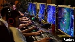 In this file photo, people play online games at an internet cafe in Fuyang, Anhui province, China August 20, 2018. (REUTERS/Stringer/File Photo)
