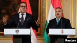 Austria's Vice Chancellor Heinz-Christian Strache and Hungary's Prime Minister Viktor Orban address a news conference at the Hungarian embassy in Vienna, Austria, Jan. 30, 2018.