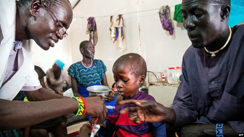 A Medical Officer From Doctors Without Borders MSF Attends To Child With Malnutrition