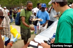 Eagle scout hands out socks in Philadelphia.
