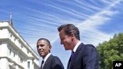 Obama e Cameron anunciam reforço de pressões sobre Kadhafi