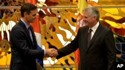 FILE - Spain's Prime Minister Pedro Sanchez, left, and Cuba's President Miguel Diaz-Canel shake hands at the Palace of The Revolution in Havana, Cuba, Nov. 22, 2018.