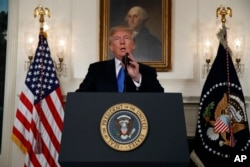 FILE - President Donald Trump speaks about Iran from the Diplomatic Reception Room at the White House in Washington, Oct. 13, 2017.