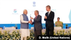 Prime Minister of India Narendra Modi receives the U.N. Champions of the Earth Award from U.N. Secretary-General António Guterres along with UNEP Chief Erik Solheim, right. The award ceremony was at the Pravasi Bharatiya Kendra in New Delhi, Oct. 3, 2018.
