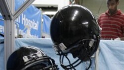 Two football helmets during tests last week at the Cleveland Clinic's Lutheran Hospital in Cleveland