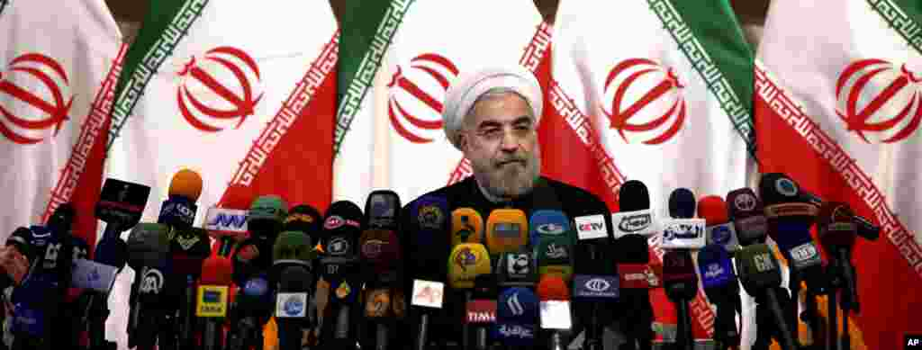 Iranian newly elected President Hasan Rowhani listens during a press conference in Tehran.