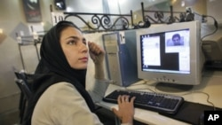 An Iranian woman uses the internet.