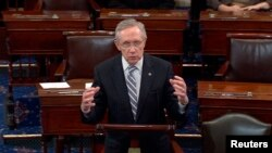 U.S. Senate Majority Leader Harry Reid announces a last-minute deal to avert a historic lapse in the government's borrowing ability, October 16, 2013.