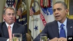 President Barack Obama, accompanied by House Speaker John Boehner of Ohio, speaks to reporters in the Roosevelt Room of the White House in Washington, November 16, 2012.