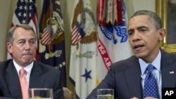 11月16日奥巴马在共和党籍众议院议长贝纳陪同下对记者发表谈话